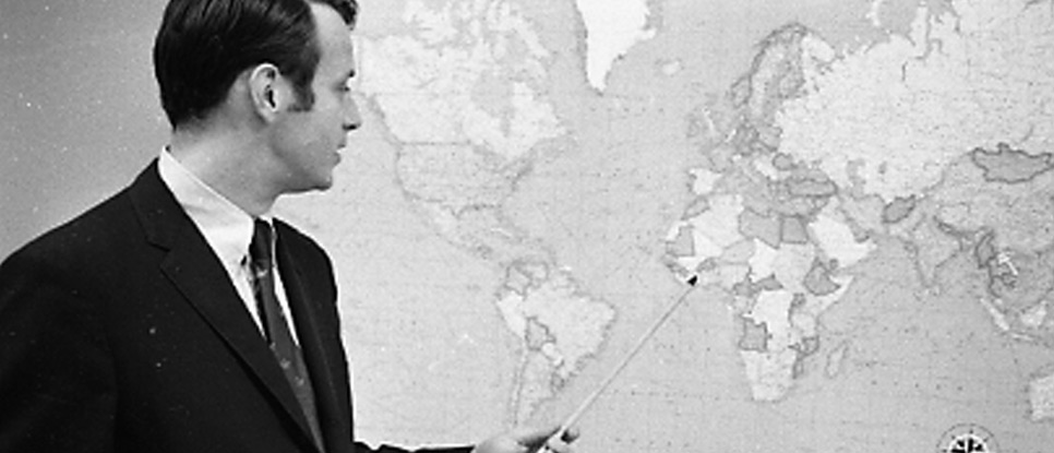 Man pointing at map