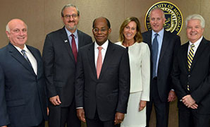 Roger Ferguson (center) was joined by Doug DiCocco, University of Michigan President Mark Schlissel, Maria Schneider, University of Michigan CFO Kevin Hegarty and Dan Conmy during a visit to the university campus in Ann Arbor, Michigan.