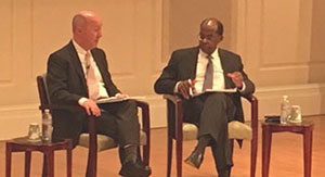 Professor Frank Warnock conducts a Q&A with Roger Ferguson during the University of Virginia Investing Conference.