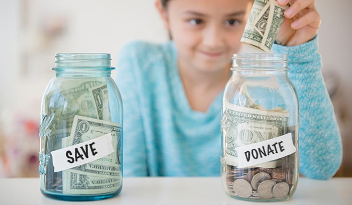 Teaching a child about money can be as simple as counting coins.>